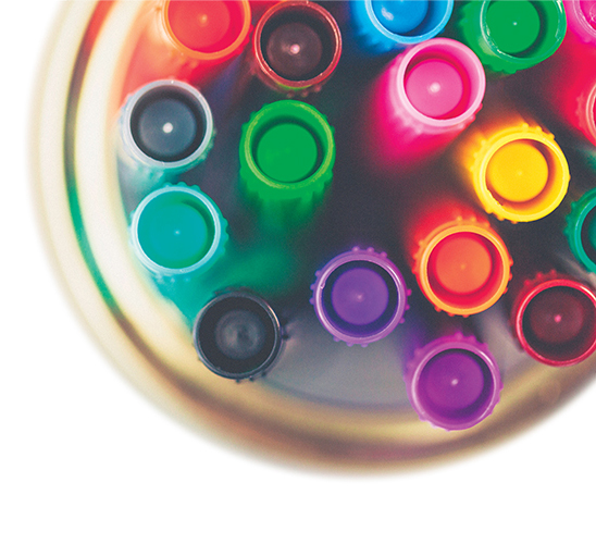 Colored markers in glass jar