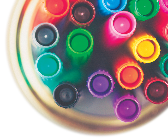 jar containing multi-colored markers