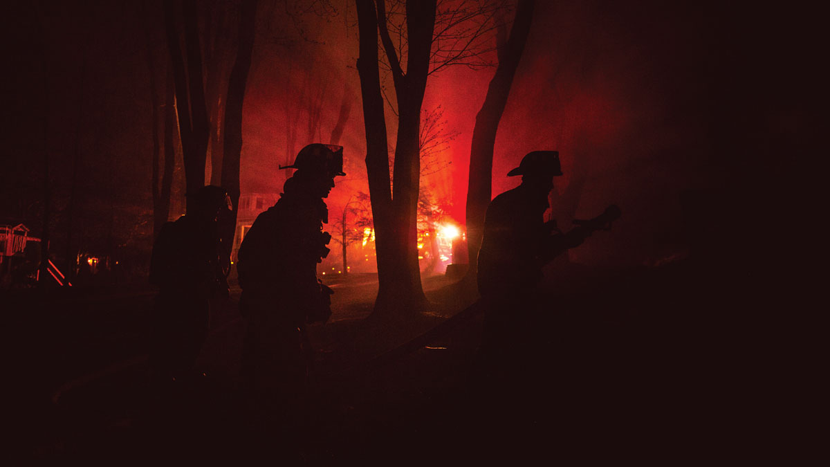firefighters walking through woods