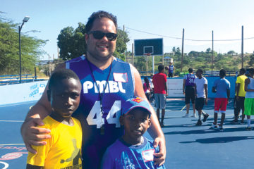 ben kay with kids on a basketball court