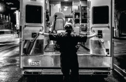 a medic opening an ambulance door