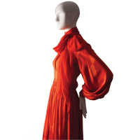 a red dress on a mannequin