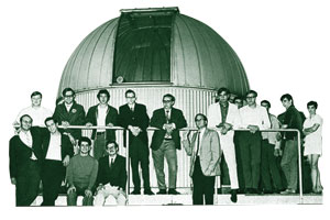 students around the telescope