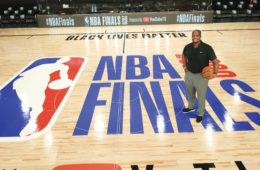 Malik Rose standing on an NBA court