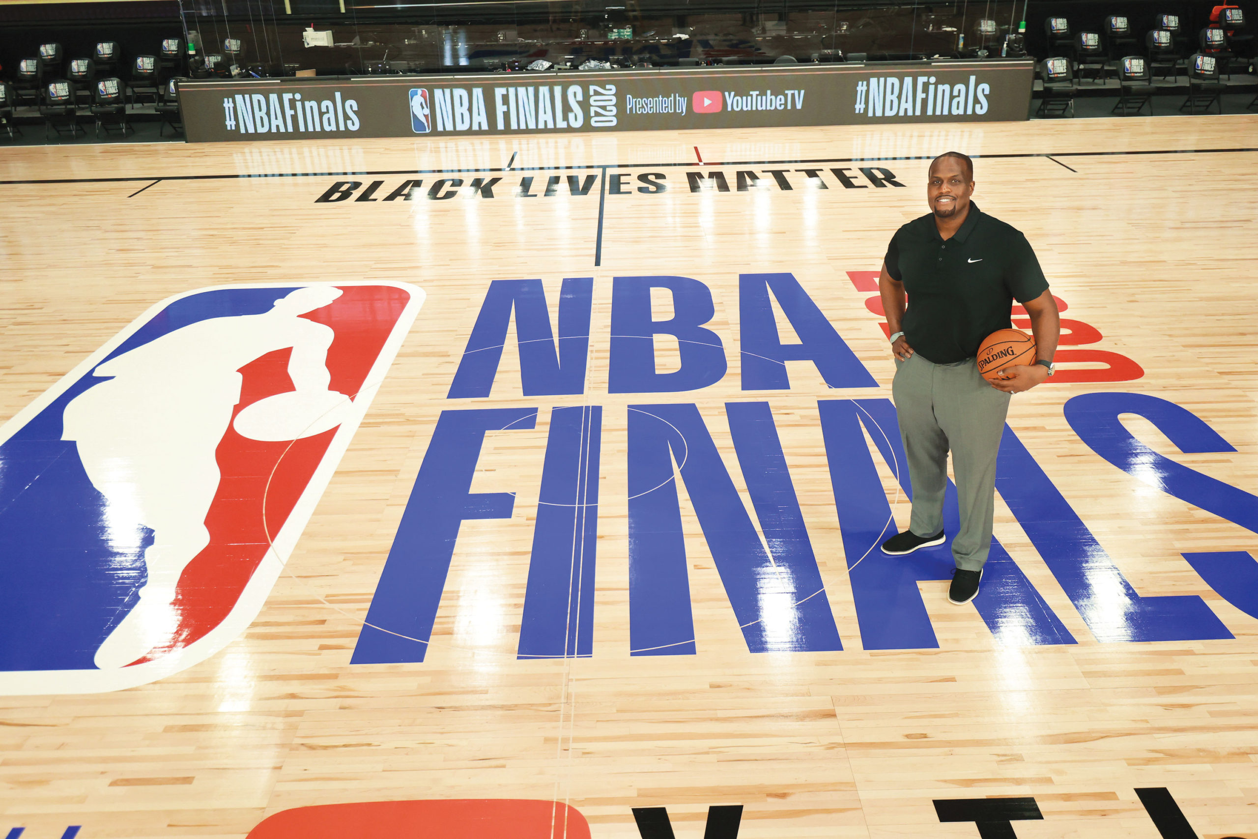 Malik Rose standing on an NBA court