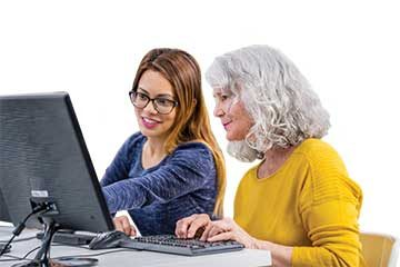 two women on a computer